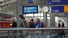 Young people wait for train in Berlin Central train station, Germany Stock Footage