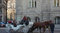 Tourist sit and ride in a horse carriage, Berlin, Germany Stock Footage