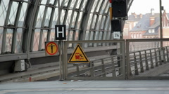 Slippery platform warning sign at train station, Berlin, Germany Stock Footage