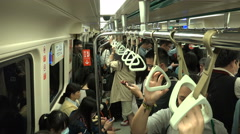 People riding the Taipei subway, interior view of a metro carriage in Taiwan Stock Footage