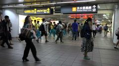 Commuting subway passengers in Taipei main railway station, Taiwan Stock Footage