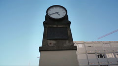 Historical clock in front of Humboldt University, dolly in, Berlin, Germany Stock Footage