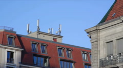 Stock Video Footage of Cellphone antennas on orange rooftops in the city, Berlin, Germany