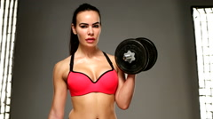 woman with dumbell Stock Footage