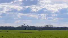 Historic windmill pasture Netherlands - stock footage