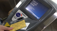 Subway passengers swipe their public transport cards, metro exit, Taipei, Taiwan Stock Footage