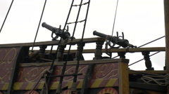 Cannons on the Golden Hinde II vessel in London Stock Footage