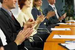 Businesspeople clapping hands Stock Photos
