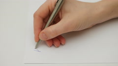Female hand writes My dear friend on the paper Stock Footage