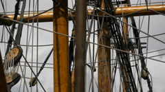 Close up view of Golden Hinde II vessel's masts with ropes in London Stock Footage