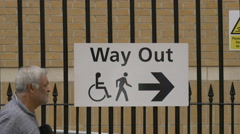 Way out sign on a fence in London Stock Footage
