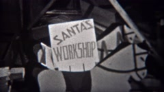 1943: Santa's workshop hammering and sawing making toys for kids. STATEN ISLAND, Stock Footage
