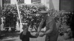 1943: Retired World War 1 veteran denied holding grand daughters hand. STATEN Stock Footage