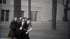 1943: Military uniformed man brings plans to group of women well wishers. STATEN Stock Footage