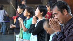 Taiwan religion, Buddhism, Taoism, Confucianism, people praying in temple Stock Footage