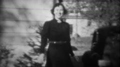Stock Video Footage of 1939: Femme fatale women in black tries on man's hat at funny gag joke. TRYON,