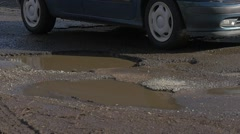 Vehicle is Driven by Wet Road City Day Opole Poland Car Number Puddles Water in Stock Footage
