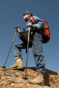 Travellier with rucksack - stock photo