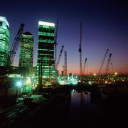 Canary Wharf and cranes on Thames Stock Photos
