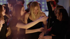 Girls hugging on dancefloor Stock Footage