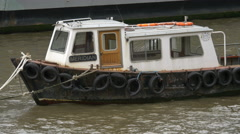 Meridian boat moored on the Thames in London Stock Footage