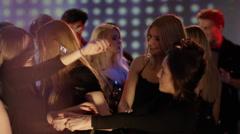 Girls hugging on dancefloor - stock footage