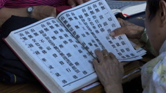 Asian religion, woman reads ancient texts, Chinese characters, language, Taiwan Stock Footage