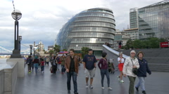 People walking close to the City Hall of London Stock Footage