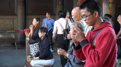 Asia, Taiwan religion, young and old pay tribute to ancestors Stock Footage