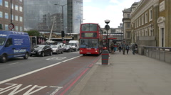 Driving cars and buses on Borough High St in London Stock Footage