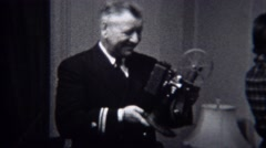 1944: Military general inspects modern film projector technology device. MIAMI, Stock Footage