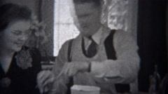 1944: Man wearing apron serving mother food at formal dining table. MIAMI, - stock footage