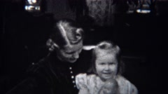 1944: Mother daughter rocking chair with baby doll and big smiles. MIAMI, Stock Footage