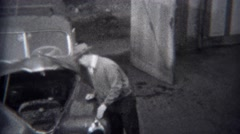 1944: Man inspecting hood opened car engine of classic Buick car.  MIAMI, Stock Footage
