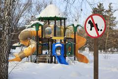 Sign forbidding dog walking on children's sports playground Stock Photos