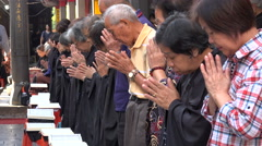 Asia, senior Taiwanese worshipers, religious ceremony, Longshan temple in Taipei Stock Footage