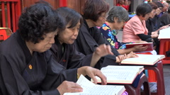 Asia religion, senior Taiwanese women read religious Chinese textbooks Stock Footage