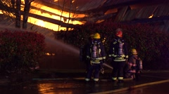 Firefighters Spraying Water At Fire Stock Footage