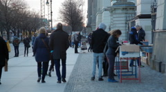 Crowd of people walk and look shop at book fair, Humboldt University, Berlin Stock Footage