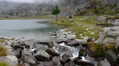 Cornisello lake and waterfall Stock Footage