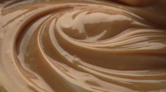 Mixing dense chocolate cream with egg whisk. Macro video - stock footage