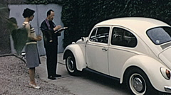 Austria 1967: priest blessing a Volkswagen Beetle - stock footage