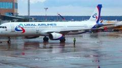 MOSCOW, RUSSIA : Airbus A319 of Ural Airlines towing at Domodedovo Stock Footage