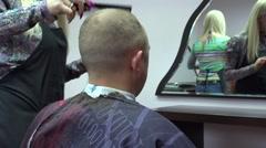 Stylist woman hands cut short customer man hairs in barber salon. 4K Stock Footage