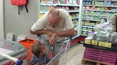 Grandson and granddad talking and shopping - stock footage