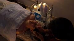 Chinese massage scraper gouache. Face massage. Stock Footage