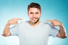 Happy man with half shaved face beard hair. - stock photo