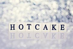Written word of tiles with letters - hotcake - stock photo