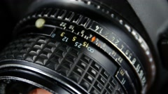 Wheel on camera aperture, close up Stock Footage
