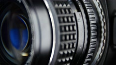 Camera diaphragm opening, close up, cam moves to the right - stock footage